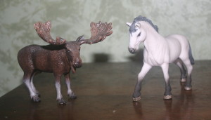 Pet pony and his friend, the moose.